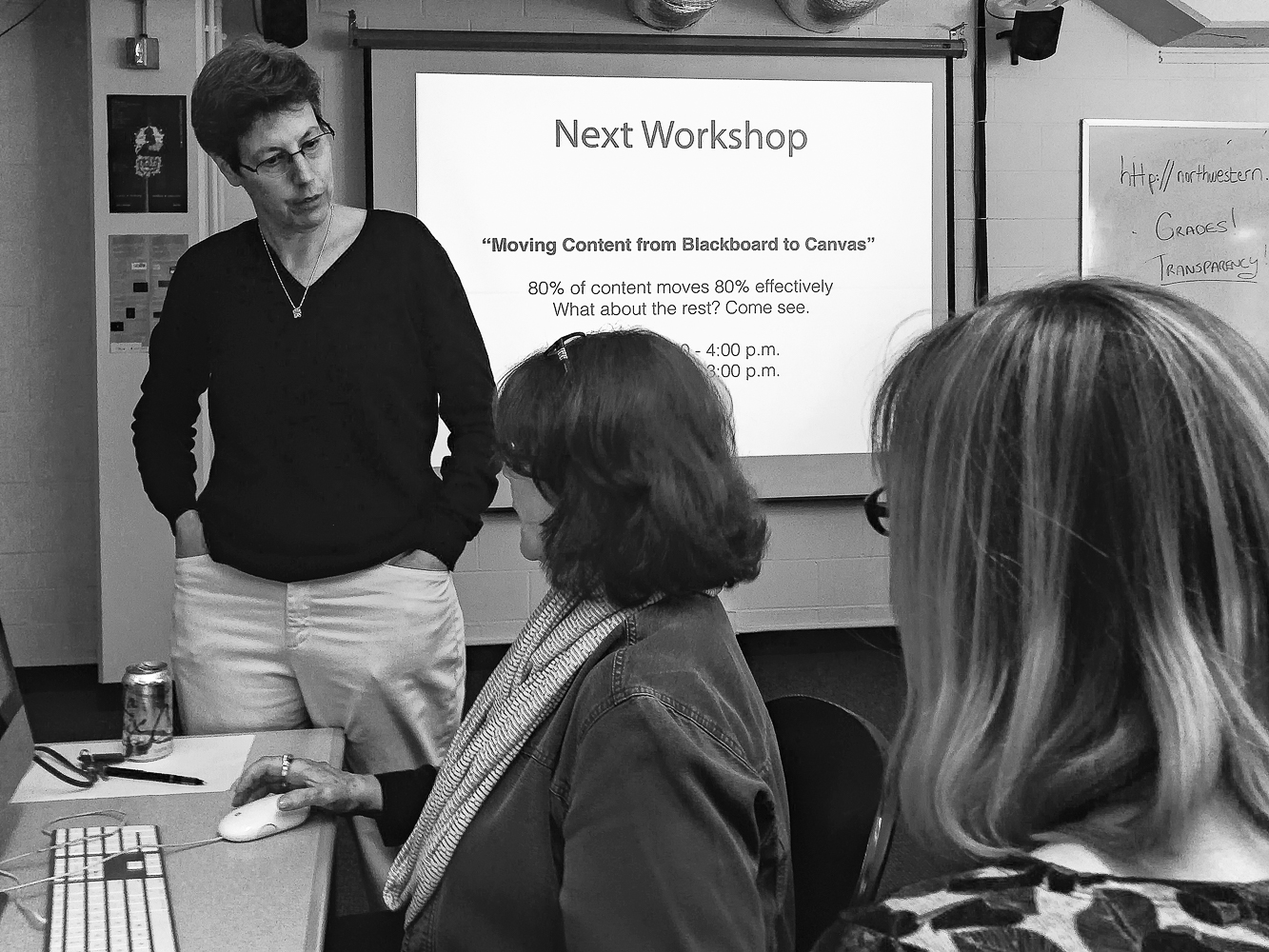 """A blast from the past… the """"old"""" MMLC lab in Kresge Hall with a co-led MMLC - NUIT workshop on migrating content to Canvas…  Vicki Getis from NUIT talks with Penny Fahey (middle) as Katrin Volkner listens."""