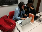 Two students working at a desk