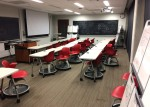 White steelcase brand desks and red node chairs